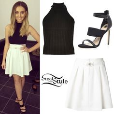 Perrie Edwards posted a picture two days ago wearing a River Island Black Ribbed High Neck Top ($40.00), the Kenzo Pleated Skirt ($588.00) and a pair of River Island Black Snake Print Three Strap Sandals ($100.00).