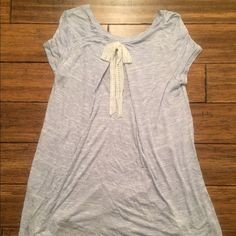 Bow Tie Back Tunic Flowy tunic t-shirt with a lace bow tie in back. Brand new retail - did not come with tags. Tops Tees - Short Sleeve