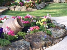 I can do this w/ the Vinca coming out of it! How to Apply Landscape Rock Beautifully - Garden Lovin