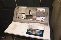 An IBM Key Punch machine which operates like a typewriter except it produces punched cards rather than a printed sheet of paper. -- I use to have a love/hate relationship with this machine.  I used in it High School 1977-79, College for computer programming (1980-81), and up to 1990 while working with computers in the Air Force.