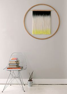 black, white and yellow wall hanging. in love!