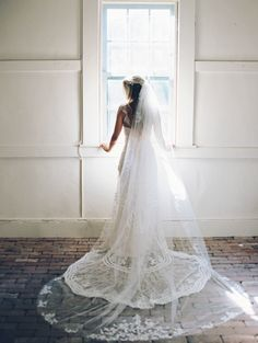 Dreamy lace tipped veil portrait: http://www.stylemepretty.com/2015/11/16/sweet-summer-garden-wedding/ | Photography: Nina and Wes - http://ninaandwes.com/