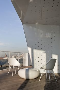 Milan Rooftop, Furniture by Driade, Lago Chair designed by Phillipe Starck with the Koishi Table/Bench by Naoto Fukasawa available through Studio Guell