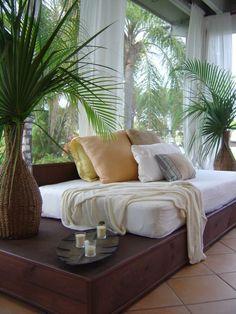 Love the airy sheer drapery panels in this tropical sunroom. www.budgetblinds.com/walnutcreek