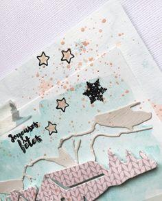 Une carte en scrapbooking réalisé pour Les Jolies créations avec les papiers, tampons, et matrices de la marque ainsi qu'en touche d'aquarelle.inspiration hivernale
