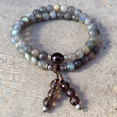 54 bead mala bracelet, made with hi-tec elastic, that will stretch and allow you to use it as a wrap bracelet! (We add tiny metal beads to increase sizing). Made with genuine high quality faceted labr