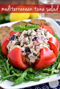 Mediterranean Tuna Salad is fresh and light. Serve in a tomato, on a salad, between two slices of bread, or with crackers! | iowagirleats.com