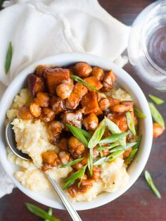 Chickpeas and tender chunks of sweet potato are simmered in sweet and zesty barbecue sauce and served atop creamy polenta to make these satisfying bowls.