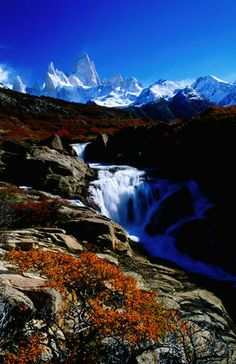 Monte Fitz Roy rises above a waterfall.