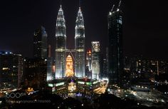 KL by night - The majestic Petronas towers in its full glory during the nights  According to the Council on Tall Buildings and Urban Habitat (CTBUH)'s official definition and ranking they were the tallest buildings in the world from 1998 to 2004 and remain the tallest twin towers in the world at 451.9 mtrs. The towers were designed by Argentine architect Cesar Pelli. They chose a distinctive postmodern style to create a 21st-century icon for Kuala Lumpur