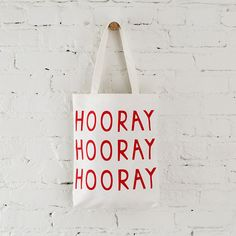 Lift your spirits with this happy tote bag.