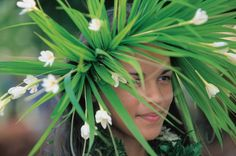 A Tahitian Vahine (woman) with a flower crown