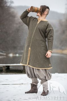 Viking Inspired tunic from soft wool with leather edging and hand embroidery.