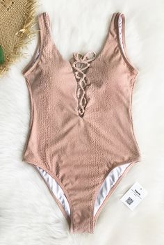 Treat yourself to something special~ Cupshe Sweet Love Solid One-piece Swimsuit features special soft fabric with linging and lace up at front. Pink color brings you back to your girlhood! FREE shipping. Shop now.
