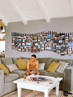 This is kinda cute.  Can't make up my mind if I like it or not!  Lol  Dune Fence Picture Display  via Coastal Living An undulating model of a dune fence holds family photos and enforces the beach friendly feel of the space in this surfer-cool living room in Santa Cruz, CA. Love it!