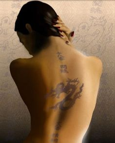 Best Dragon Tattoos – Our Top 10 embossed style seductive style