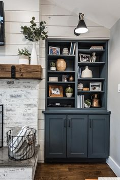 Shiplap and German Smear fireplace with concrete hearth cap and rustic mantel. Styled built-in cabinets with a pop of co Fireplace Built Ins, Farmhouse Fireplace, Fireplace Remodel, Concrete Fireplace, Fireplace In Kitchen, Fireplace With Cabinets, Fireplace Hearth Decor, Fireplace Bookshelves, Shiplap Fireplace