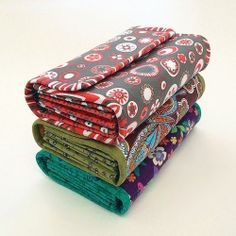 The wallet that fits everything! Check out these three wallets made from a sewing pattern from NapkittenPatterns.