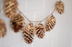 DIY gold leaf pine cone garland - love it