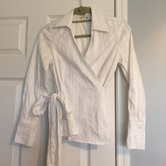 Ann Taylor LOFT striped metallic wrap blouse Gently worn. Has textured white strips with threads of silver. Shirt ties around the waist. No trades!! LOFT Tops Blouses
