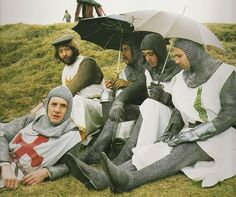 Michael Palin, Graham Chapman, Eric Idle and two extras during a break from filming Monty Python and the Holy Grail.