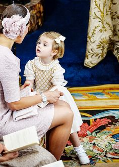 Crown Princess Victoria of Sweden with her daughter, Princess Estelle at the christening of Princess Leonore daughter of Princess Madeleine and Christopher O'Neill. June 8, 2014.