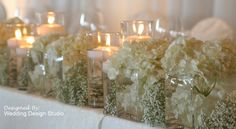 With the candles and Baby's Breath, this could be very budget friendly if you used white carnations instead of hydrangea.