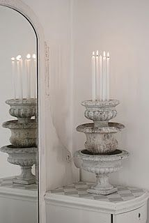 Urns...stacked, top filled with sand and candles Great lighting idea!!