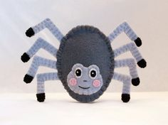 Made from 100% wool felt, this itsy bitsy spider finger puppet is 2.5 inches tall. Each piece is hand cut and sewn together one tiny stitch at a time. No glue or beads are used.