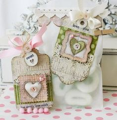 Good chipboard techniques on this Lilibean post  Like the embossing w machine, then white paint.  Also felt heart window.