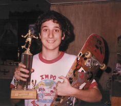 A young Harmony Korine, skateboard and trophy!
