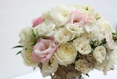 Bridal bouquet in blush and white, by Fleurie | Flower Studio, early summer. Garden roses, lisianthus, spray roses, riceflower.