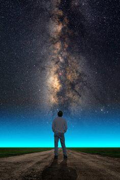 The summer Milky Way rises behind a man via Larry Landolfi