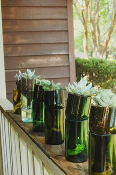 Self watering planters made from recycled wine bottles - cool idea