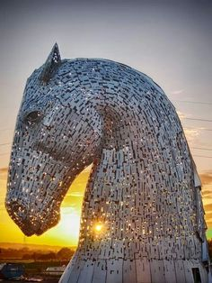 Work Continues On The Kelpies Sculptures At The Eastern Entrance - Amazing horse head sculpture lights scottish skyline
