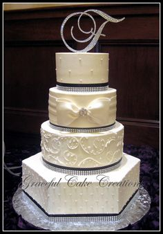 Elegant Ivory Butter Cream Wedding Cake Gray ribbon purple bow no top piece Cream Wedding Cakes, Elegant Wedding Cakes, Beautiful Wedding Cakes, Gorgeous Cakes, Wedding Cake Designs, Pretty Cakes, Amazing Cakes, Wedding Ideas, Cupcakes