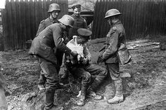 German soldiers dressed the wounds of an injured British soldier.