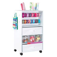"""I'd really like this! The Recollections™ Mobile Wrapping Cart is a perfect way to organize your gift wrapping supplies and move them to any wrapping space in your home! Each roll, ribbon and supply has it's own space on this fun little cart! Constructed from durable, high quality MDF board with a white finish, the cart measures 21 1/4"""" x 19"""" x 33 1/2"""". Assembly Required."""