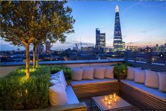 Rooftop in Bermondsey | Contemporary roof terrace with views across to the Shard lit up at night | Charlotte Rowe Garden Design