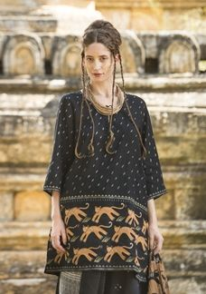 Growl! Step into the urban jungle and go a little wild in this cozy tunic with irresistible leaping tigers. Style features three-quarter length sleeves, side slits and finely tied with small tassels at the neckline.