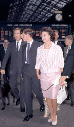 Left to right Anthony ArmstrongJones Prince Charles and Princess Margaret with a dog on a lead at Liverpool Street Station in London on 5th August...