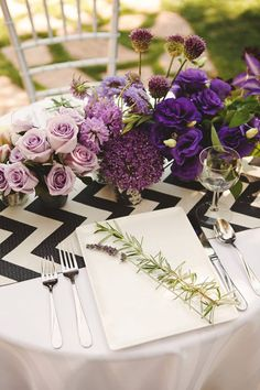 Ombre purple wedding table decor with black and white chevron table cloths.  View all the photos on our blog!  http://www.friartux.com/index.php?route=blog/blog/post&id=2062#.U2vqrYFdUSY