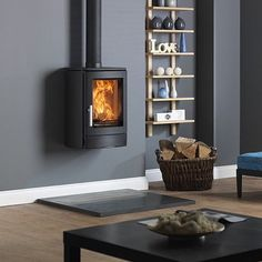 ACR Neo Stove Wall hung/ mounted from ACR Contemporary Stove range. Buy the ACR Neo from authorised ACR Stove retailers at best price Wood Stove Decor, Contemporary Wood Burning Stoves, Corner Gas Fireplace, Fireplace Tiles, Corner Stove, Wood Fuel, Multi Fuel Stove, Into The Fire, Lounge Design