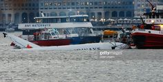Airways plane comes to rest in the water near Battery Park after crashing into the Hudson River in the afternoon on January 15, 2009 near the Battery Park neighborhood in New York City. The Airbus 320 flight 1549 crashed shortly after take-off from LaGuardia Airport heading to Charlotte, North Carolina.