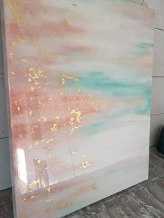 Beautiful high shine resin painting with gold leaf. Teal and light antique rose pink acrylic paint on this 24x30 canvas with an Epoxy resin overlay that gives it a glass-like shine There is also a beautiful iridescent glitter in the painting that reflects in the light without being too