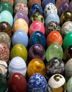 Egg shaped stones. Some are actual natural stones that have been made into eggs others are colored alabaster