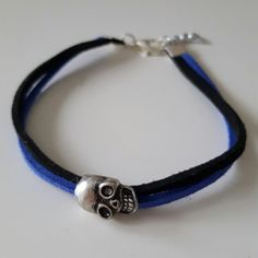 Handmade Blue and Black Suede Bracelet With a Silver Skull Charm.  #handmade #bracelet #simple #casual #elegant #marlarbracelets #blue #black #suede #silver #skull #charm #depop #summer #ireland #irish #2016