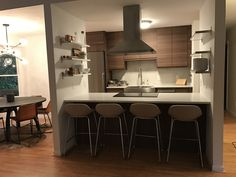 IKD customer Marie didn't lose storage when she removed all the wall cabinets above the range - thanks to the open shelving we designed for her. #IKEA #kitchen
