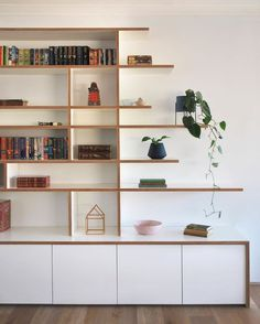 White formply working its charm in this custom built shelving and storage joinery. Built In Shelves Living Room, Bookshelves Built In, Living Room Storage, Bookcase, Living Room Modern, Home Living Room, Living Room Designs, Plywood Shelves, Custom Shelving
