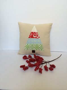 Decorate your home for the holidays with this cute Christmas appliqué pillow!  Made with 100% cotton canvas fabric.  Pieced christmas tree sewn on the front with a fun wavy decorative stitch. Trunk is permanently appliquéd.  Stuffed with high quality polyester batting by Fiberfil.  This pillow measures 15 x 15 inches and would be a great addition to your holiday decor!  Can be made in different sizes and colors. Please contact me for custom orders.